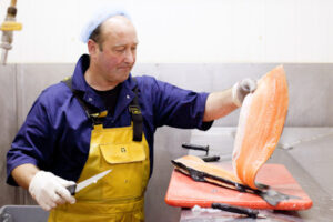 Filleting fish, fishing, smoked salmon, seashore