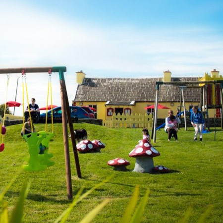 Outdoor children's play area at Stonecutter's Kitchen, family friendly restaurant