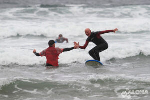 High five while surfing, Surf school adventures